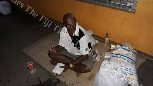 This man looks around to see if there is someone he could share his food pack with. Picture: SUPPLIED