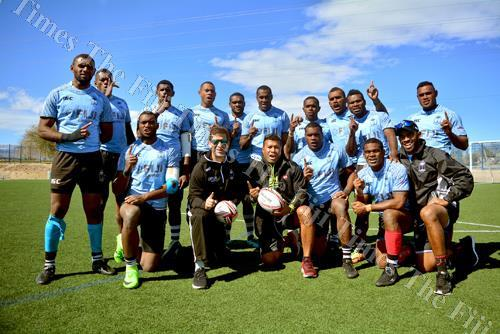 Former Fiji 7s coach Waisale Serevi with current Head Coach Gareh Baber, trainer Naca Cawanibuka with the Fiji 7s team after their captains run at the Kellog Zaher Sports Complex in Las Vegas yesterday. Picture: JOVESA NAISUA