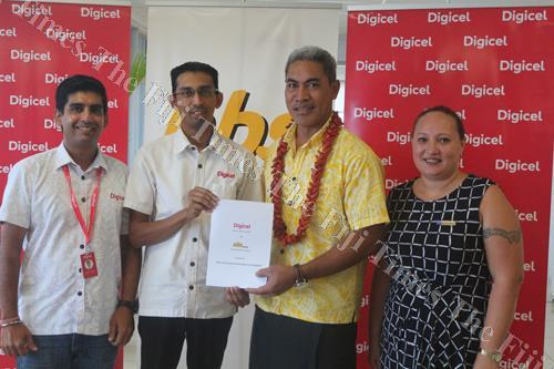 From left: Digicel Samoa chief commercial officer Deepak Khanna, Digicel chief executive officer Farid Mohammed, National Bank of Samoa chief executive officer Tu'u'u Amaramo Sialaoa and NBS chief financial officer Mariaanna Rasch after signing the offici