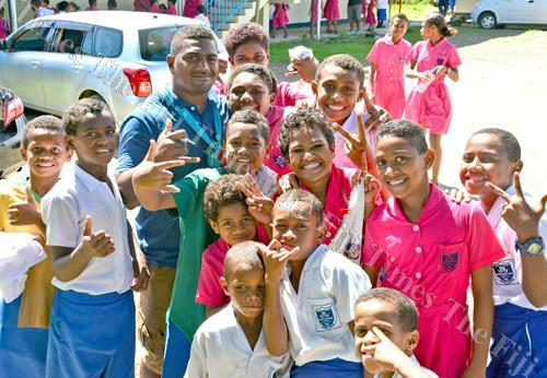 Fiji Warriors rep Mesulame Dolokoto with Draiba Primary School students during the team's visit to the school in Nasese. Picture: JONACANI LALAKOBAU