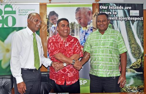 Bank South Pacific's (BSP) Lawrence Munia (left) and BSP head of marketing Nirdesh Singh (right) with South Pacific Tourism Organisation (SPTO) CEO Chris Cocker during the press conference yesterday. Picture: RAMA