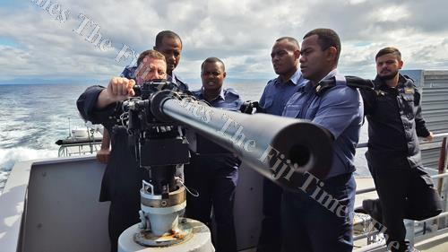Royal NZ Navy's Konrad Cook teaches members of the Fiji Naval Squadron on how to operate the 50-calibre machine gun onboard the HMNZS HAWEA in Fiji waters last year. Picture: ELIKI NUKUTABU
