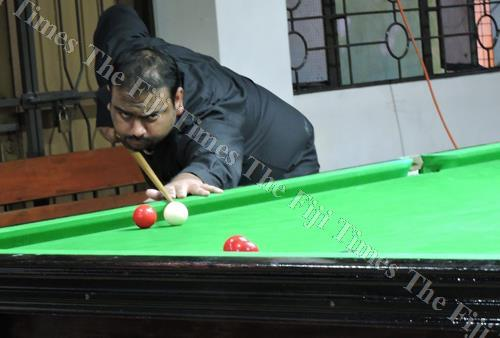 Praneel Singh lines up a shot in this photo. Singh helped his Team Merchants combination to beat Team Nausori in a three-player event. Picture: SUPPLIED