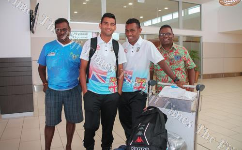 Lautoka players Zibraz Sahib and Kavaia Rawaqa return with the Vodafone Fiji soccer team from the Philippines and greeted by Lautoka soccer manager Paul Abraham (right) and a fan. Picture: FIJI FA MEDIA