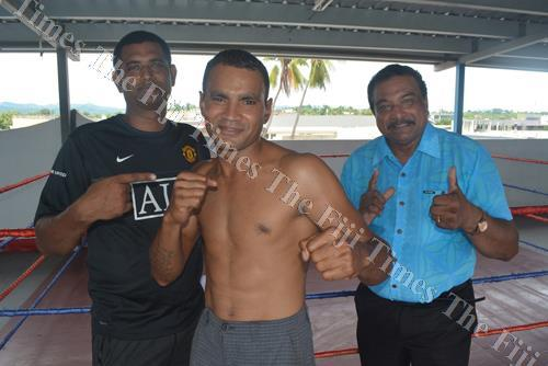 Kiran Boxing Promotion manager Shelvin Singh (left) with boxer Ronald Naidu and promoter Krishna Mudalliar pose for a photo after signing the boxing contract in Lautoka. Picture: REINAL CHAND
