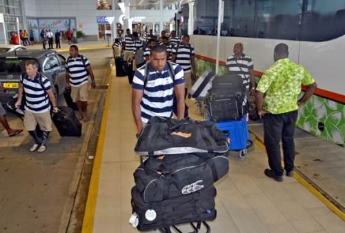 Josua Vakurinabili and members of the Fiji Airways Fiji men's team before their departure at the Nadi International Airport this morning. Picture: BALJEET SINGH