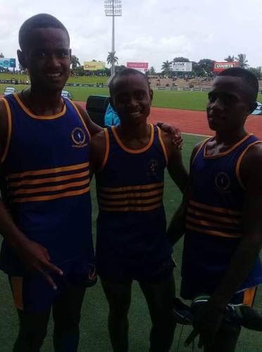 Junior boys 800m winner Manueli Sawailau (left) with colleagues Sekove Koroi and Setareki Tukeula after their race today. Picture: TALEBULA KATE