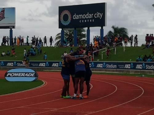 The RKS senior boys 4x400m relay team celebrate winning the final event of the day. Picture: LICE MOVONO