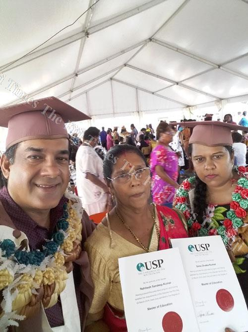 Rohitesh Sandeep Kumar with his mother and mentor Shiu Kuari. Rohitesh and his wife who both graduated with their Masters Degree in education from the University of the South Pacific last week. Picture: SUPPLIED