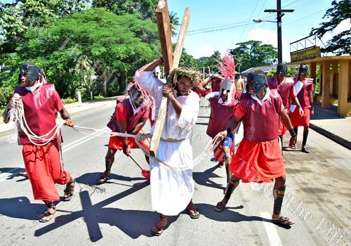 Peniasi Gade Jr plays the part of Jesus with other St Vincent de Paul Catholic Parish youths acting as soldiers during their Easter drama along the Nausori streets in 2017. Picture: JONACANI LALAKOBAU