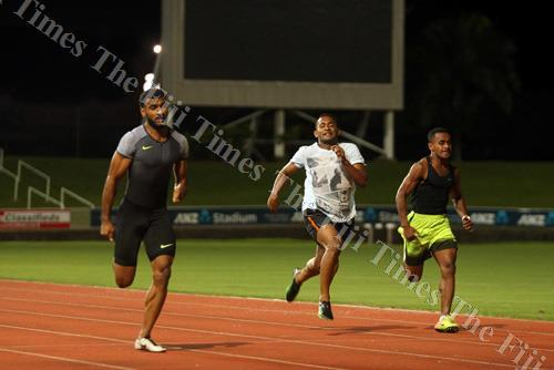 Aaron Powell (left) wins the men's 100 metres event at the ANZ Stadium on Tuesday evening. Picture: ELIKI NUKUTABU