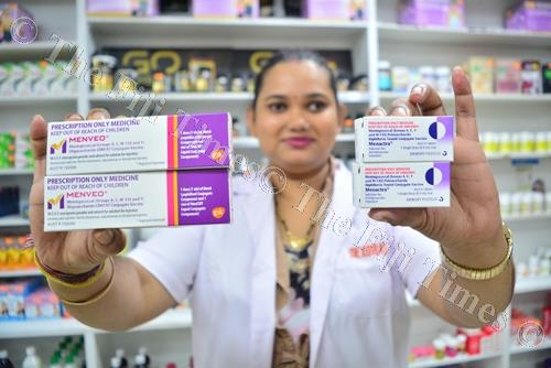 Superdrug Pharmacy Ltd pharmacist Darshana Chand holds up the two types of vaccines available in the country for meningococcal C. Picture: JOVESA NAISUA
