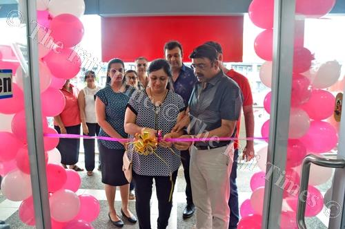 Nu-Look director Bhupen Ramji, right, and wife Bhavina cut the ribbon during the opening of Nu-Look outlet at Damodar City Centre in Suva on Thursday. Picture: JONACANI LALAKOBAU