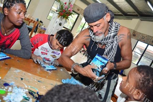Globe trotting artist Tote Gallardo shows the children of Dilkusha Girls Home how to finger paint in Nausori yesterday. Picture: JOVESA NAISUA