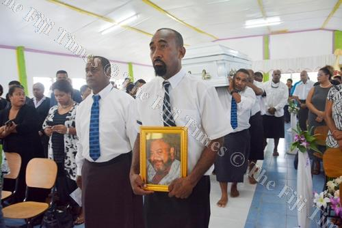 Pallbearers carry the coffin of the late Federated Airlines Staff Association general secretary Ratu Vilikesa Naulumatua during the funeral service in Nadi. Picture: REINAL CHAND