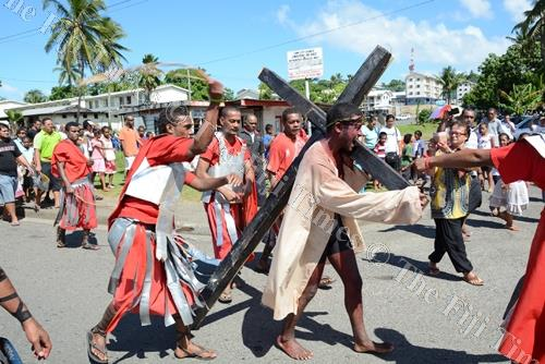 Youths act out Jesus carrying his cross. The author says the meaning of Easter has to be relevant to the individual in terms of adressing his or her questions, problems and anxieties. Failing to do this, we simply are handing on a tradition or custom unco