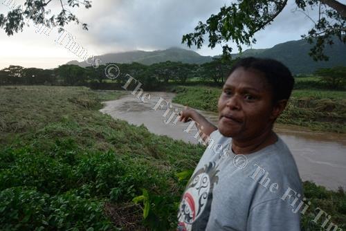 Jokaveti Vakavunivala points to the river where Ilaisa Nabou went missing at Naboutini, Sabeto in Nadi yesterday. Picture: BALJEET SINGH