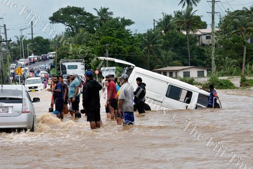 A vehicle is swept away into a drain by strong currents at Waimalika in Sabeto, Nadi yesterday. Picture: BALJEET SINGH