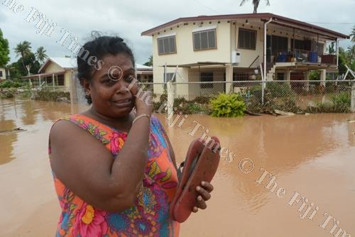 Kiran Devi in front of her flooded home in Yalalevu, Ba. Devi occupies the bottom flat as a tenant. Picture: REINAL CHAND