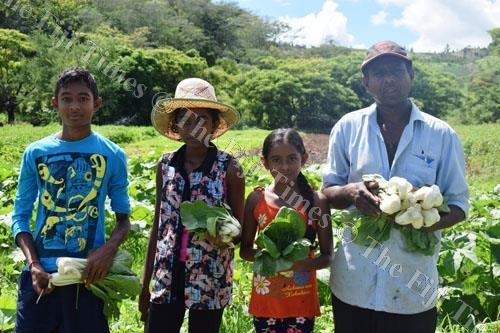 Sushil with his three children on his farm at Tavarau in Ba. Picture: SUPPLIED