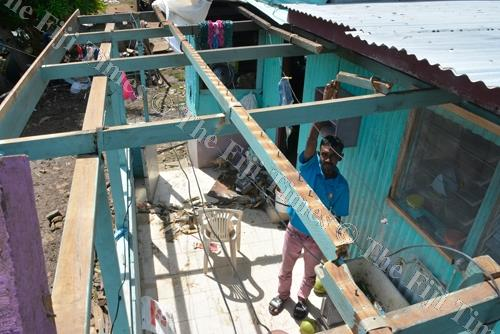 Mohammed Rizwan shows the damaged roof of his home in Karavi, Ba. Picture: REINAL CHAND