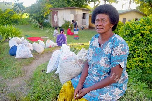 Melaia Vugona of Nadrala Village in Nadroga sits beside the road with her sack of kai (freshwater mussels). Picture: SOPHIA RALULU
