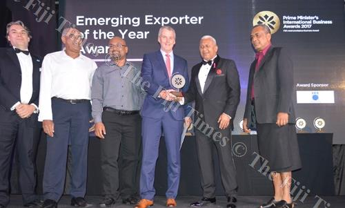 Paradise Beverages (Fiji) general manager Mike Spencer (fourth from left) accepts the Emerging Exporter of the Year Award from PM Voreqe Bainimarama during the Prime Minister's International Business Awards late last year. Picture: SUPPLIED