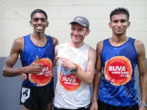 Simon Grimstrup, middle, with Fiji marathon reps Kennol Narayan, left, and Raj Prasad. Picture: SUPPLIED