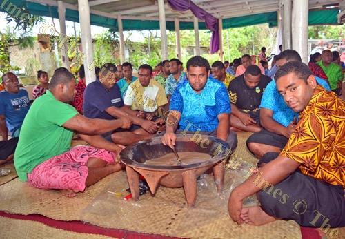 Members of the Matakibau reunite around a tanoa of grog. Picture: JOVESA NAISUA