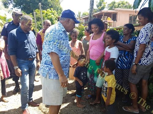 Prime Minister Voreqe Bainimarama reassures children at Nawaka Tramline settlement in Nadi that Government will assist them recover from the floods. Picture: FELIX CHAUDHARY