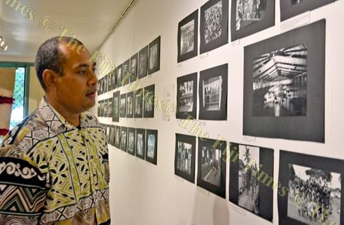 Ben Fong views some of the displayed photographs during the art exhibition at Oceania Centre for Arts, Culture and Pacific Studies (OCACPS) at USP Laucala campus in Suva yesterday. Picture: JONACANI LALAKOBAU