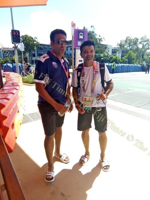 Romit Parshottam, left, and Sailesh Pala wait for a train at the Commonwealth Games Village in Brisbane, Australia. Picture: MAIKELI SERU