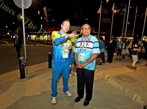 Former Suva resident Timothy Wilcox leads the President on a tour of the Games Village. Picture: ELIKI NUKUTABU