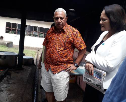 Prime Minister Voreqe Bainimarama with his health minister Rosy Akbar at Navesau Adventist High School. Picture: Luke Nacei