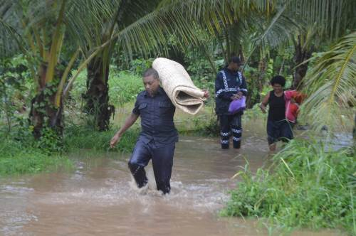 Police officers help evacuate families living in low-lying areas of Vulovi in Labasa. PictureL SERAFINA SILAITOGA
