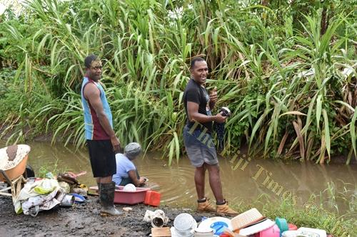 Residents of Bila, Naviyago settlements wash their household items at a nearby creek in Lautoka. Picture: SUPPLIED/FRIEND FIJI