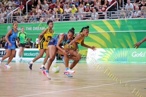 Fiji's Verenaisi Sawana blocks off a Jamaican player during their match at the Gold Coast Convention & Exhibition Centre in Australia yesterday. Fiji lost 88-30. Picture: ELIKI NUKUTABU