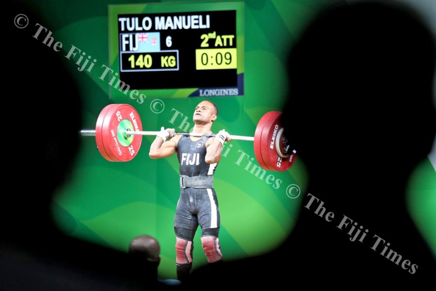 Manueli Tulo clears his 135kg clean and jerk lift during the Commonwealth Games. Picture: ELIKI NUKUTABU
