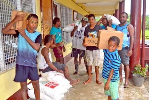 Evacuees receive food rations from Government in Labasa yesterday. Picture: LUKE RAWALAI