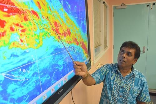 Fiji Meteorological Service director Ravind Kumar explains the weather patterns on a map during a media briefing in Nadi yesterday. Picture: REINAL CHAND