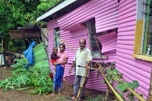 Baram Deo and his wife Maya Wati with their grandchild Pranish Chand are thankful to be alive after their house was hit by a landslide. Picture: LUKE RAWALAI