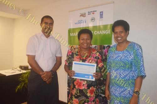 Adi Bale Maramarua, middle, after being presented her certificate for being part of a workshop organised by UN Women for Lautoka market vendors. Beside her are representatives from UN Women who facilitated the workshop. Picture: SHAYAL DEVI