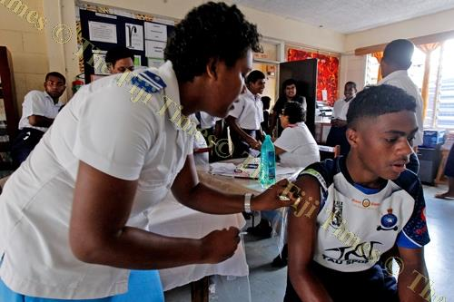 A Navesau Adventist High School Year 12 student gets vaccinated at the school in Wainibuka. Picture: JONA KONATACI