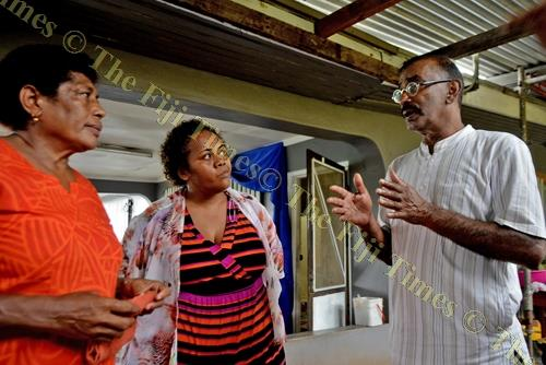 Former Lautoka and national soccer rep Abbas Ali, right, with the late Pita Dau's sister Miliana Vukitu, left, and wife Mere Tulo at Banaras in Lautoka yesterday. Picture: BALJEET SINGH