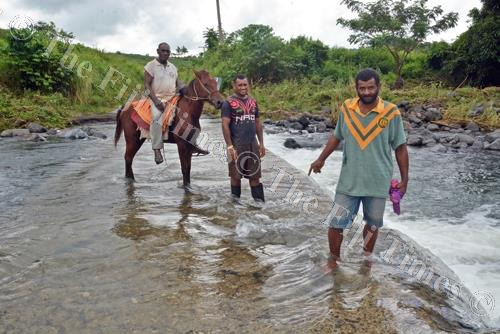 Eliki Duanacoko (right) shows the Tabutabu bridge where Ratu Masi was swept away by floodwaters in Nadelei, Tavua. Picture: REINAL CHAND
