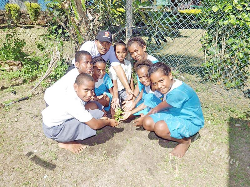 Mana SDA Primary School head Ben Turner and students pose with their yasi plant last week. Picture: SUPPLIED