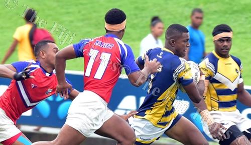 Jiuta Wainiqolo of RKS beats the MBHS defence during the Fiji Secondary Schools Ruggy League under-19 semi-finals at the ANZ Stadium in Suva yesterday. Picture: ATU RASEA