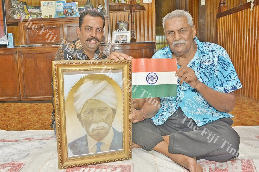 Keshwa Prasad Sharma (left) with his father Sat Narayan holds a picture of their late grandfather who had once motivated them to visit India, their place of origin. Picture: BALJEET SINGH