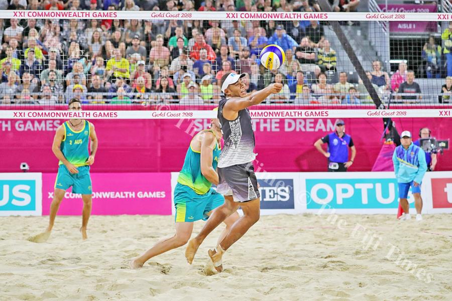 Fiji's Sairusi Cavula receives a spike against Australia during the Commonwealth Games beach volleyball competition at Coolangatta Beachfront in Gold Coast, Australia. Picture: ELIKI NUKUTABU