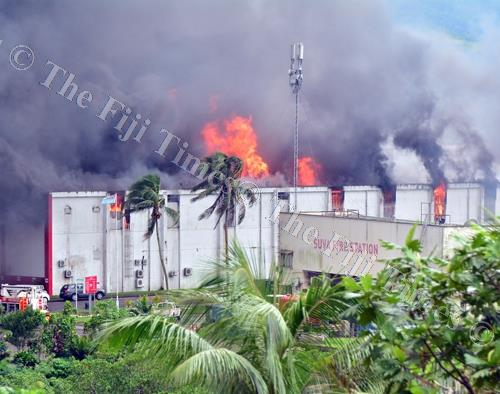 Firefighters try to put out the fire at the MH warehouse and Carpenters administration building in Walu Bay, Suva yesterday. Picture: JONA KONATACI